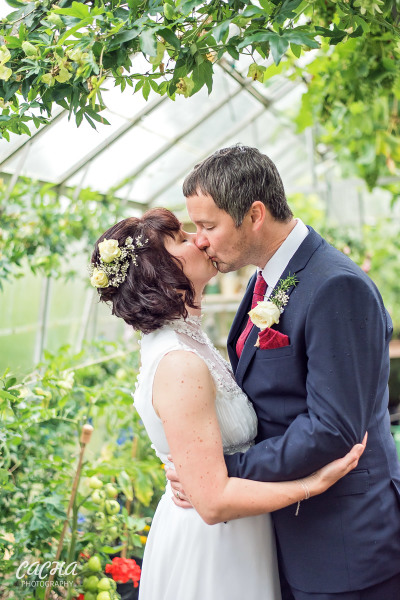 Romantic photo of bride and groom at Crook Hall and Gardens, Newcastle wedding photography by Cacha Photography
